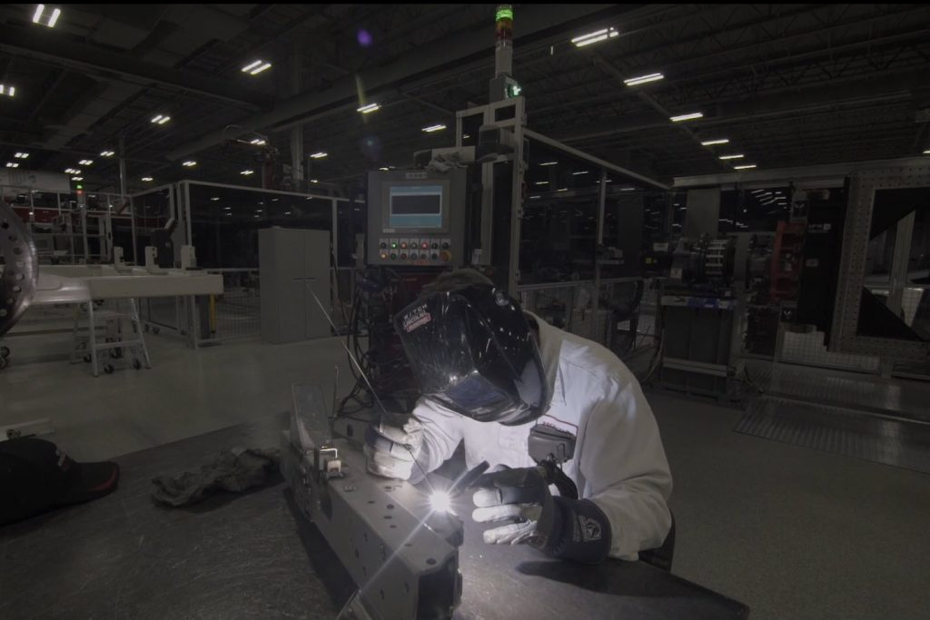 a tech welds at PMC