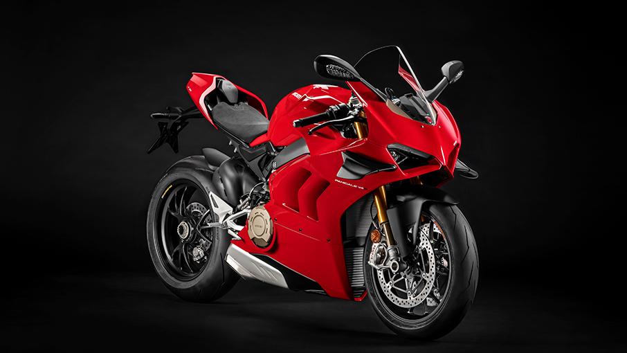 dark backdrop press photo of a Red 2020 Ducati  Panigale V4