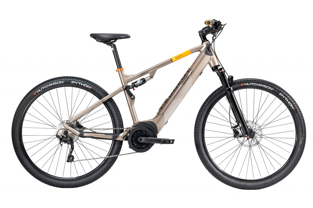 A tan-framed Peugeot eT01 Crossover FS e-bike