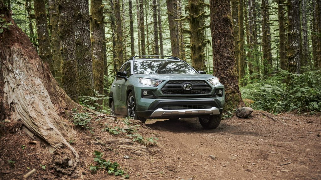 2020 Toyota RAV4 TRD Off Road trim driving on dirt trail