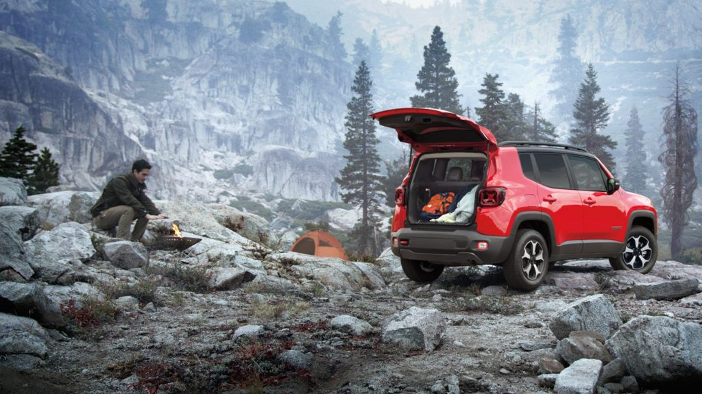 Man camping on mountain top with the off-roading Jeep Renegade
