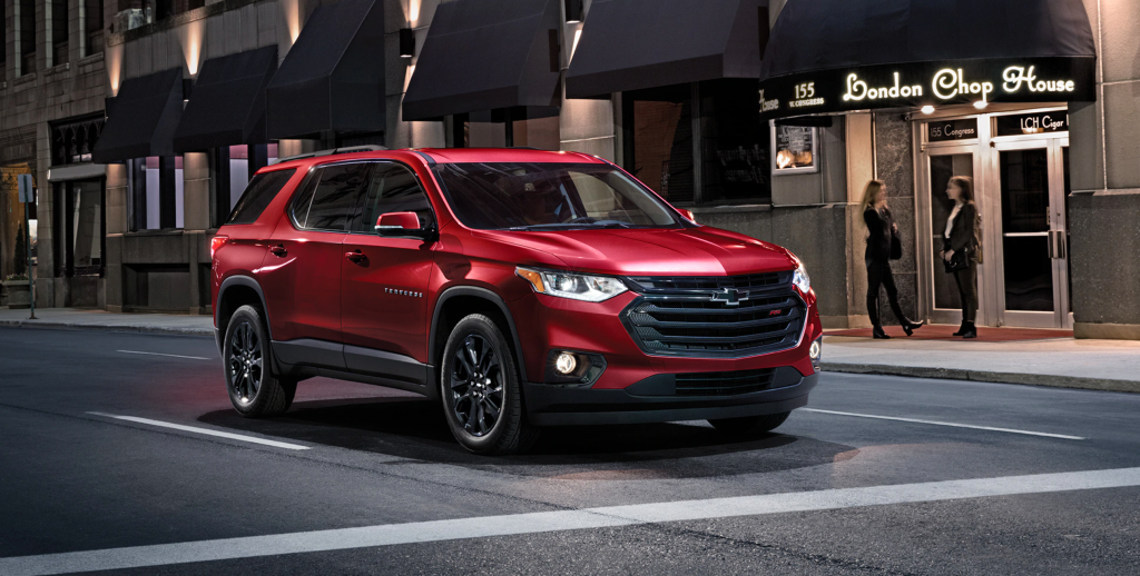 2020 Chevy Traverse driving on city street at night