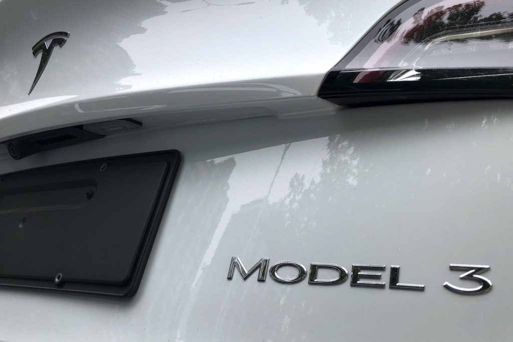 The rear badge of a white Tesla Model 3 is seen on July 17, 2020 in Beijing, China