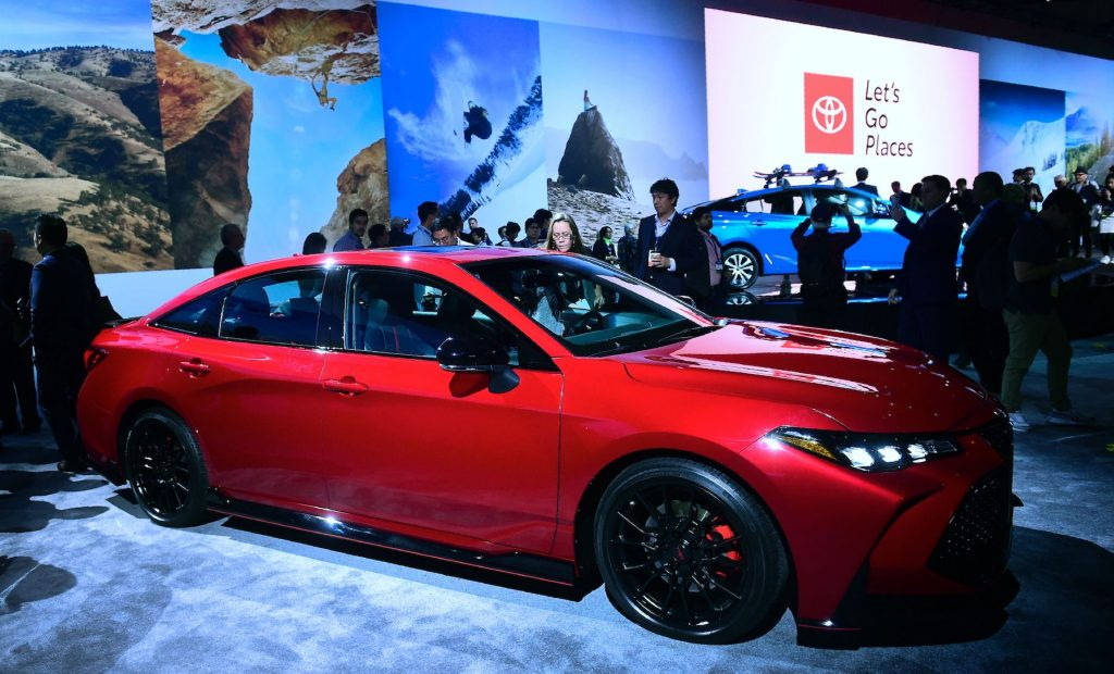 People take a closer look at the new 2019 Toyota Avalon TRD on display in Los Angeles, California