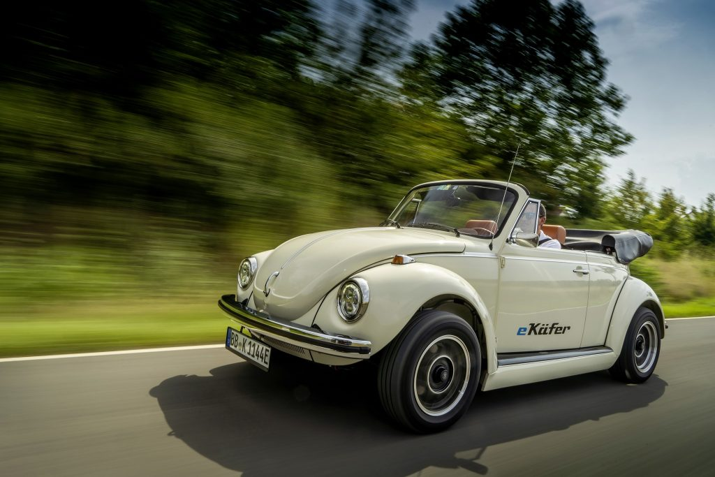 A white classic Volkswagen Beetle convertible converted to electric power
