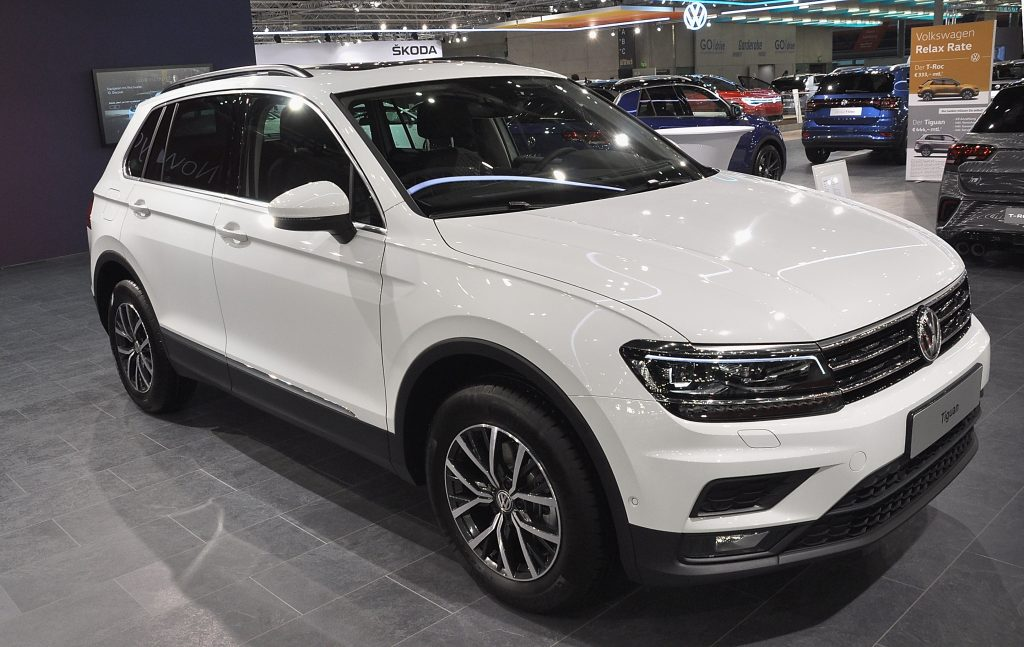 A white Volkswagen Tiguan on display at an auto show