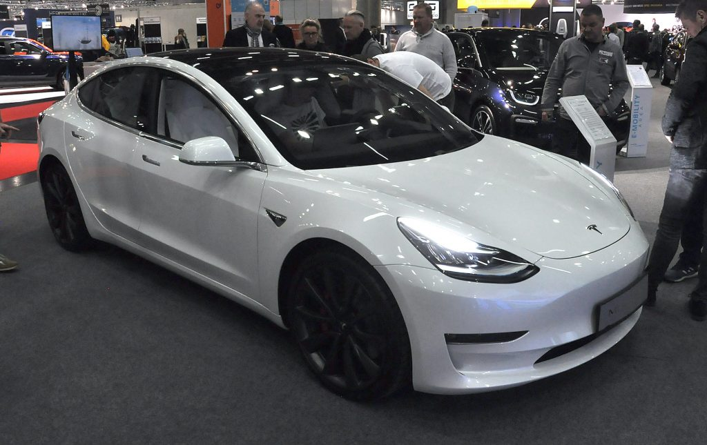 A white Tesla Model 3 is seen during the Vienna Car Show press preview