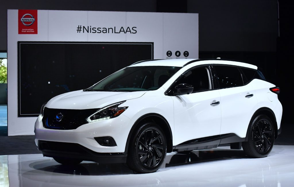 A white Nissan Murano on display at an auto show