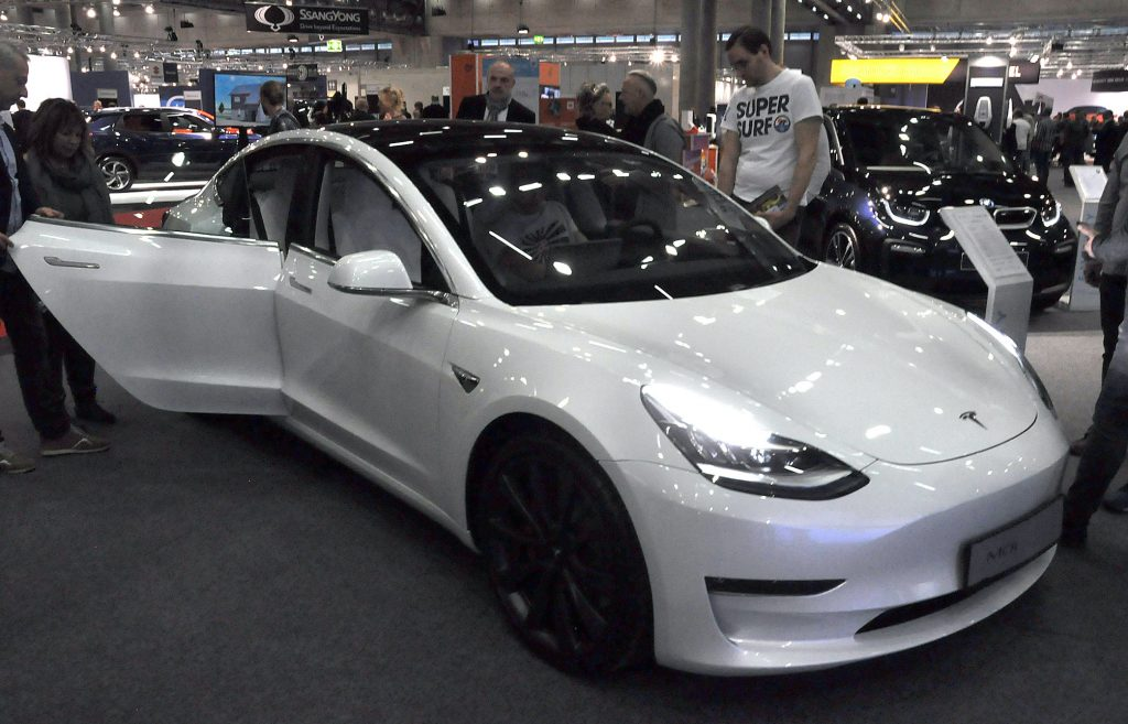 A white 2020 Model 3 is seen during the Vienna Car Show press preview at Messe Wien, as part of Vienna Holiday Fair