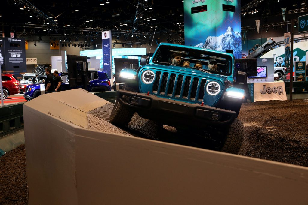 A 2020 Jeep Wrangler Rubicon makes its way through the 'Jeep Experience Articulation' exhibition at the 112th Annual Chicago Auto Show