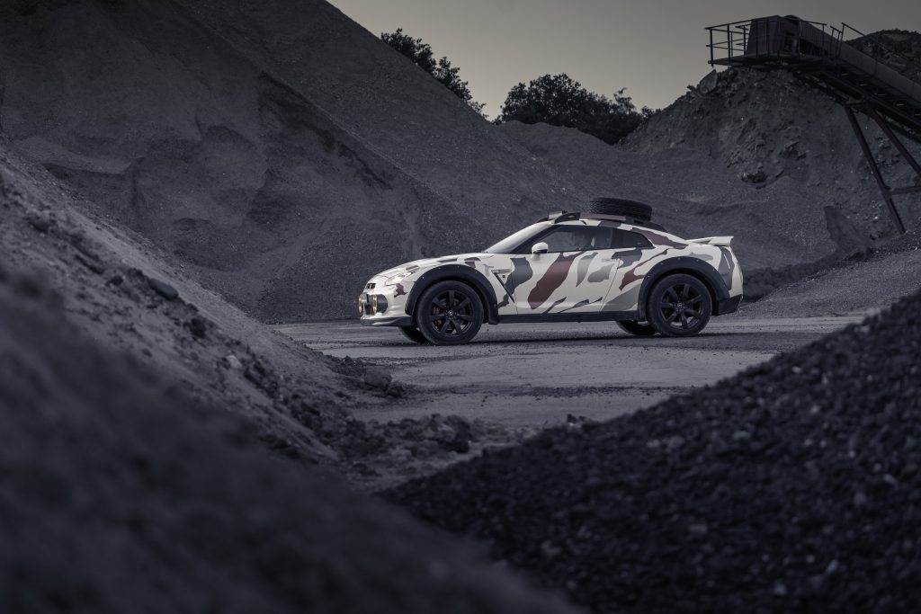 The camo-wrapped R35 Nissan GT-R modified by Classic Youngtimers Consultancy parked in a quarry
