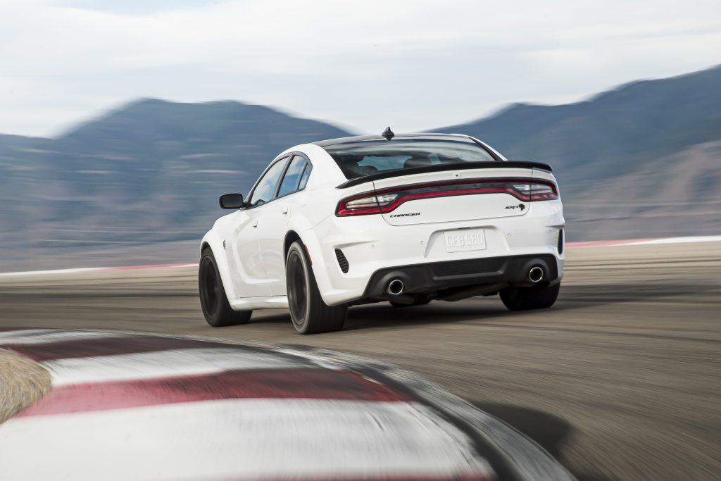 exterior trunk rear view of a 2021 Dodge Charger at speed on a track