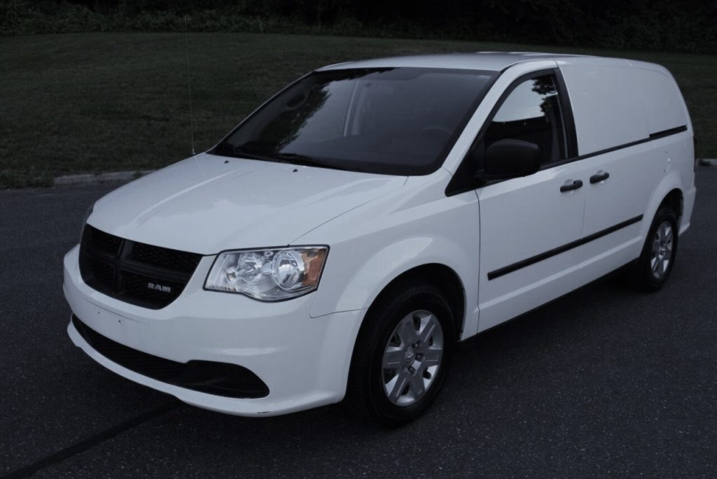 a white Ram Tradesman that looks like a Dodge caravan but with a acreage van twist