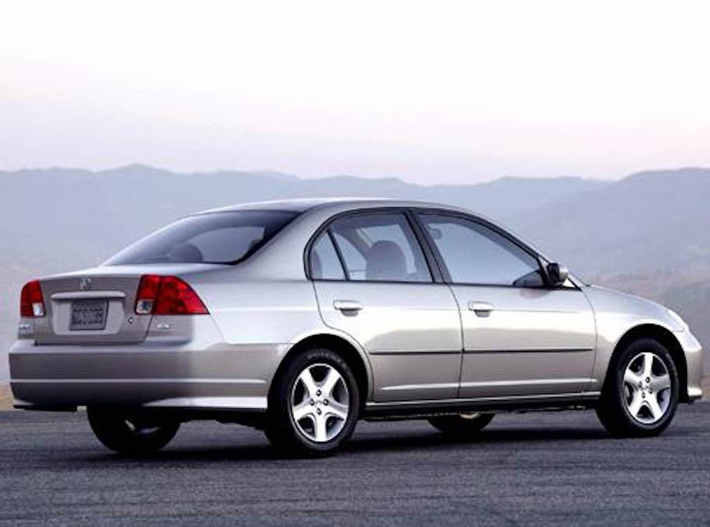 side rear view of the 2004 Honda Civic sedan with a mountainous background