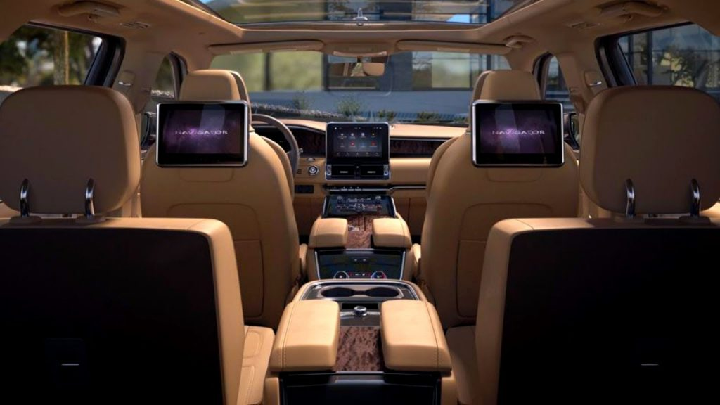 The inside of the 2020 Lincoln Navigator that's been upgraded with a rear-seat entertainment system and much more room than a g-wagon