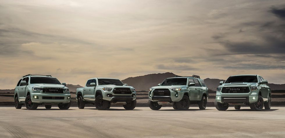 the 2021 TRD Pro lineup in lunar rock in a sandy scene