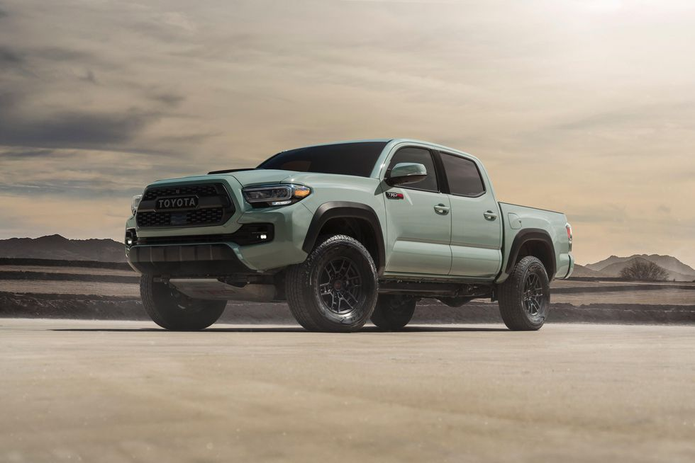 a 2021 toyota tacoma trd pro showing of its aggressive stance in the desert