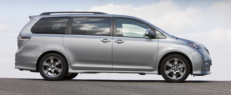 side view of a silver 2011 Toyota Sienna