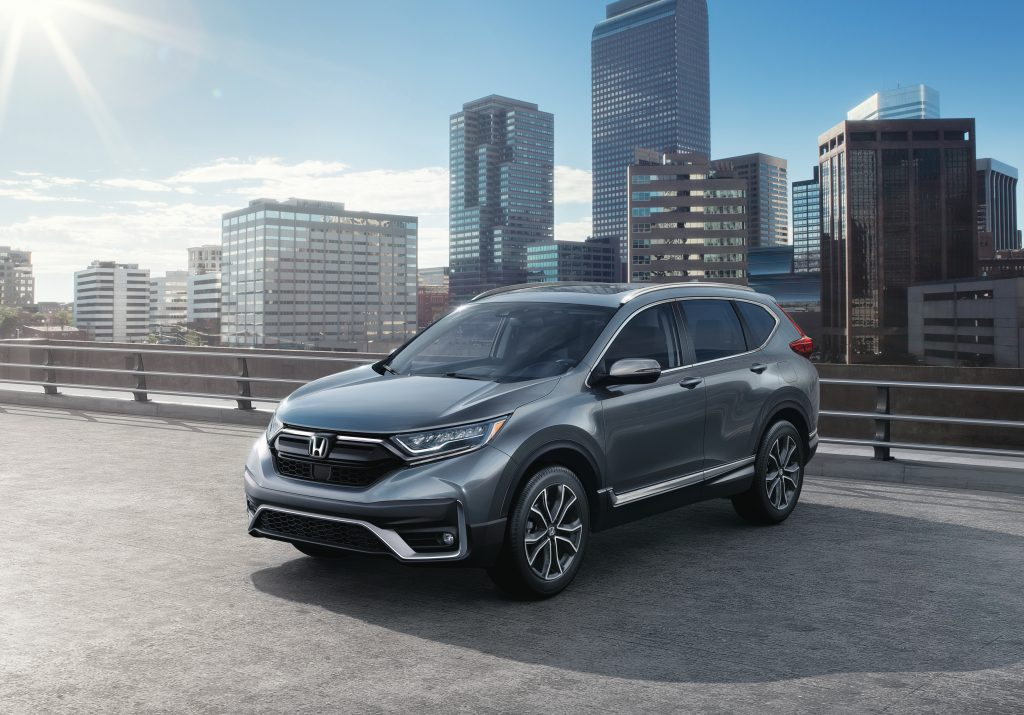 A sharp, gray 2020 Honda CR-V Touring model parked in the city.