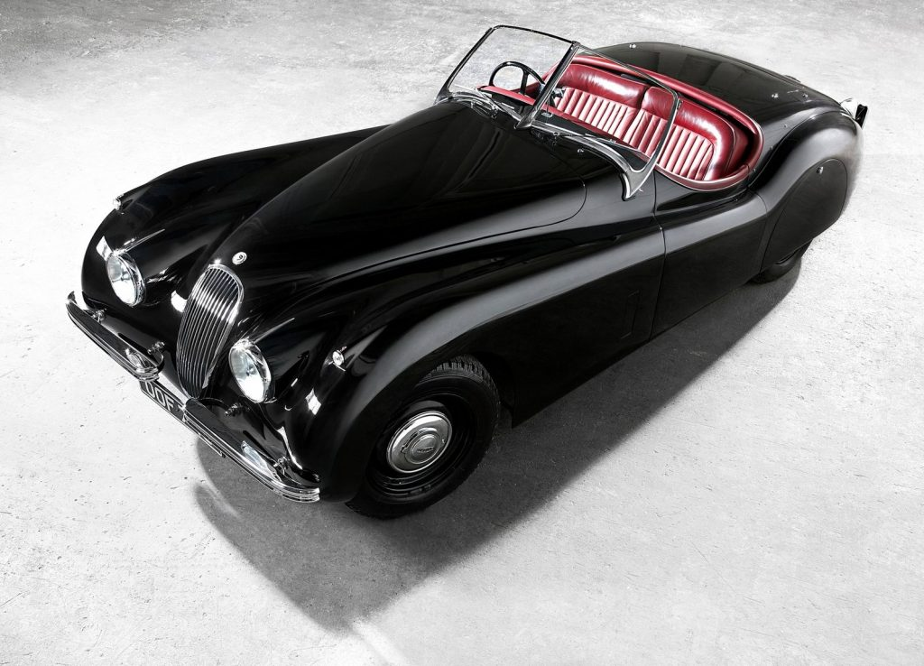 A black 1948 Jaguar XK120 without its roof