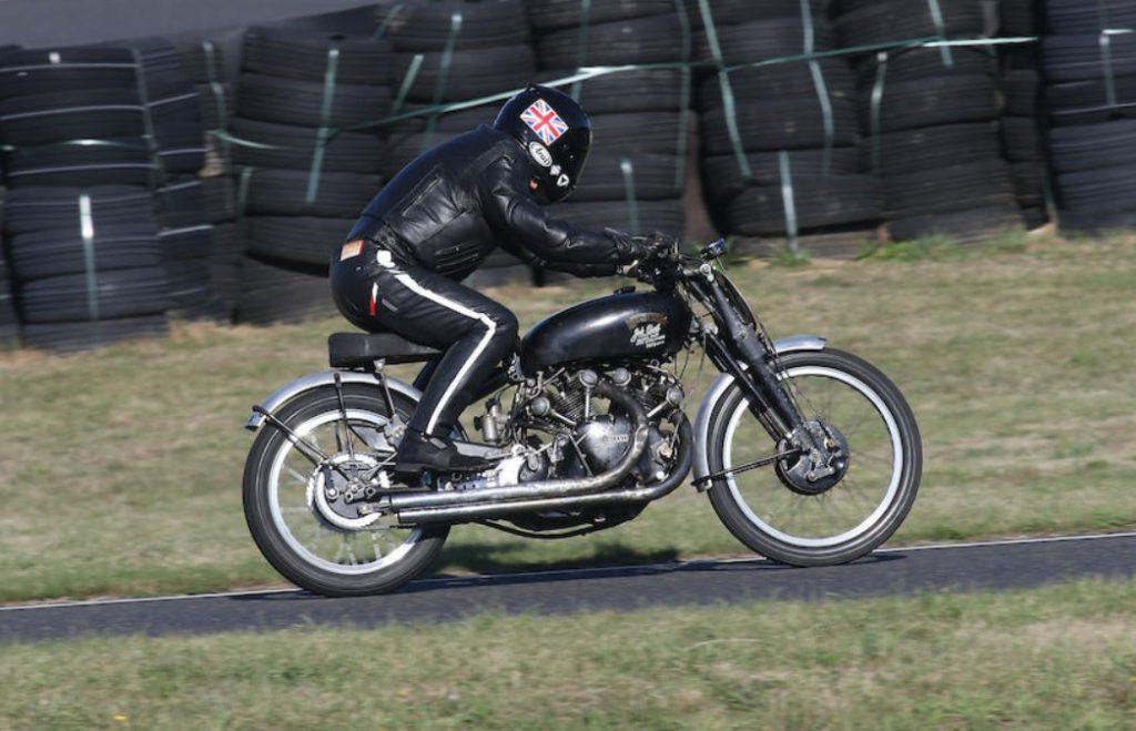 A leather-clad rider on a 1951 Vincent Black Lightning