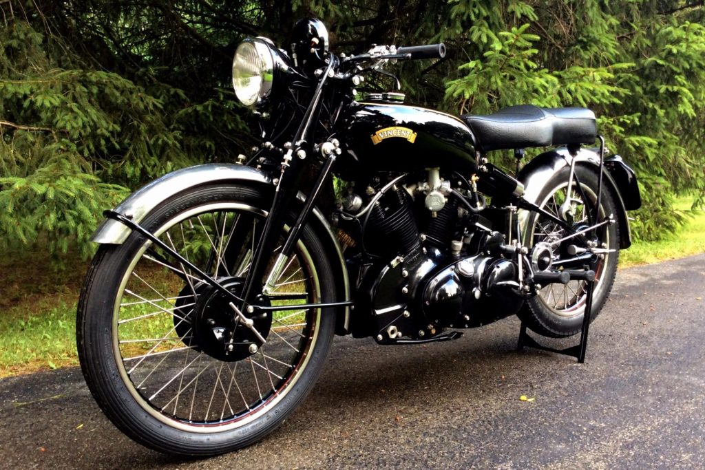 A 1953 Vincent Black Shadow Series C in front of some trees