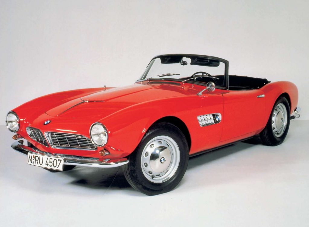 A red 1955 BMW 507 roadster with its top down