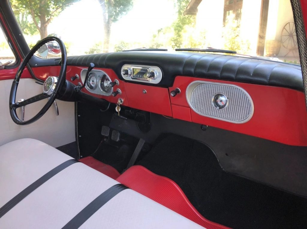 The red-and-white interior of a 1962 Studebaker Champ