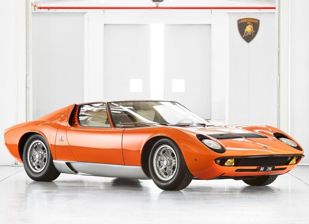 An orange 1968 Lamborghini Miura P400 in Lamborghini's studio