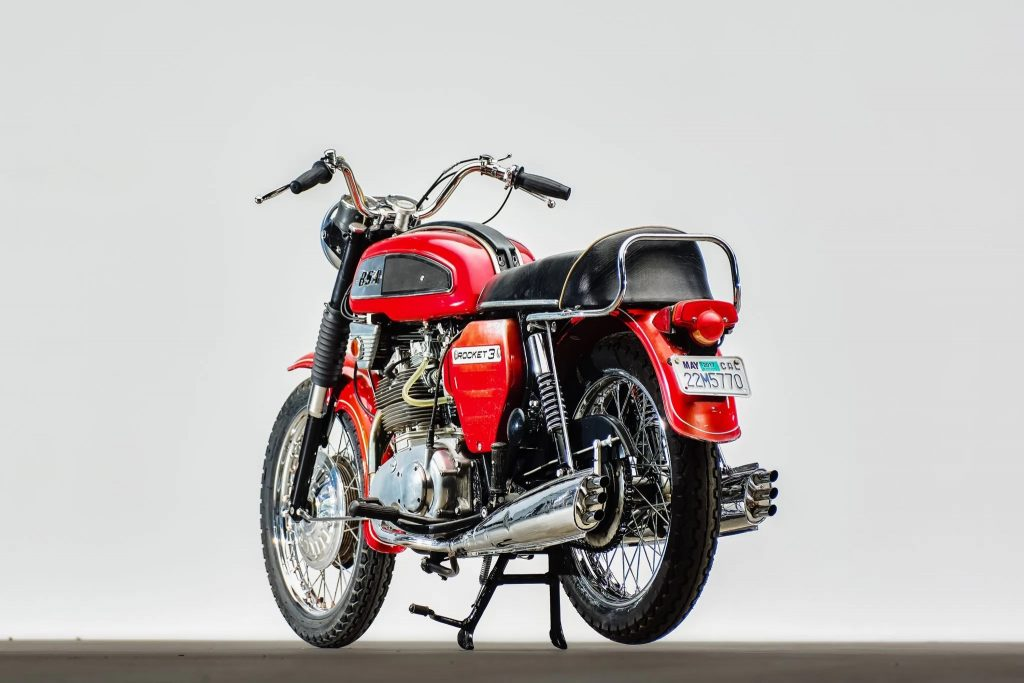The rear-3/4 view of a red 1969 BSA Rocket 3