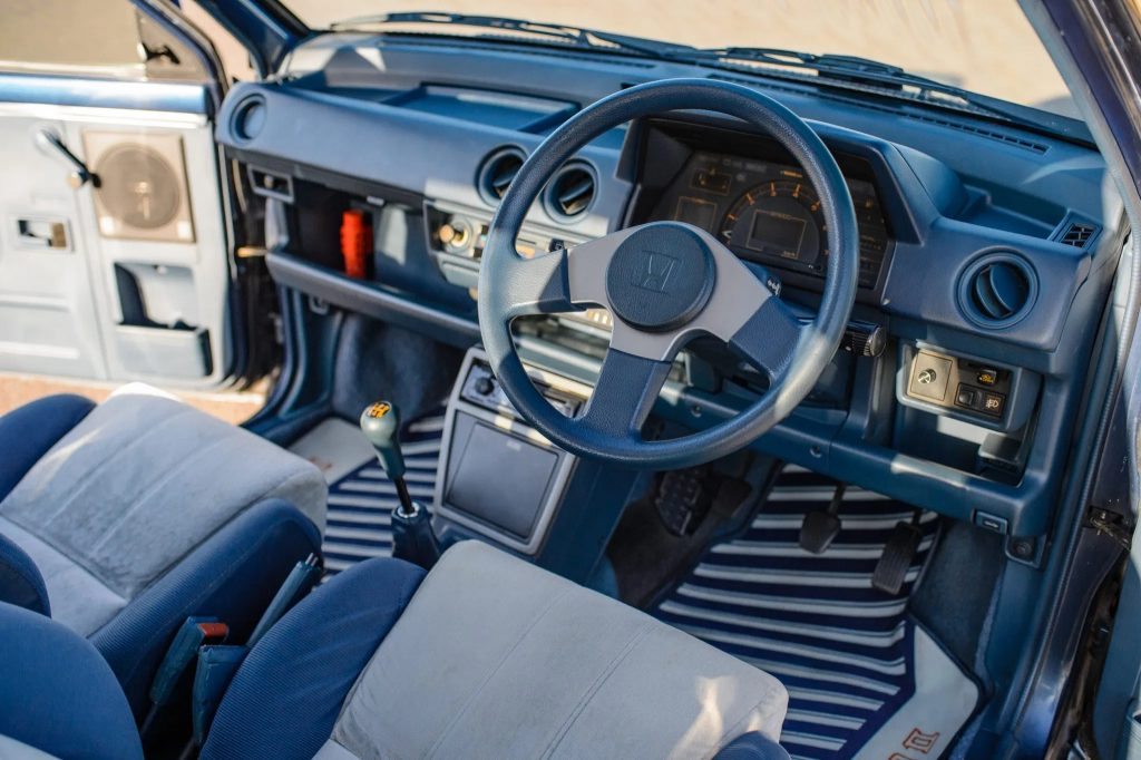 The front seats and dashboard of a 1983 Honda City Turbo II