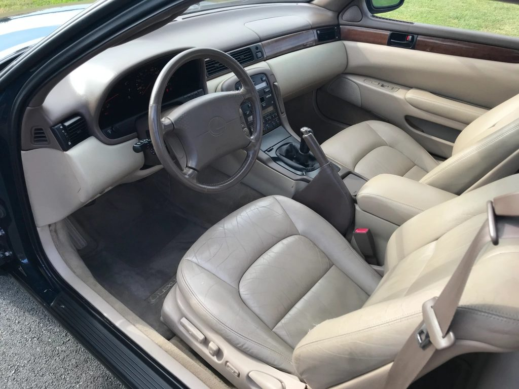 The tan leather interior of a manual-equipped 1996 Lexus SC300