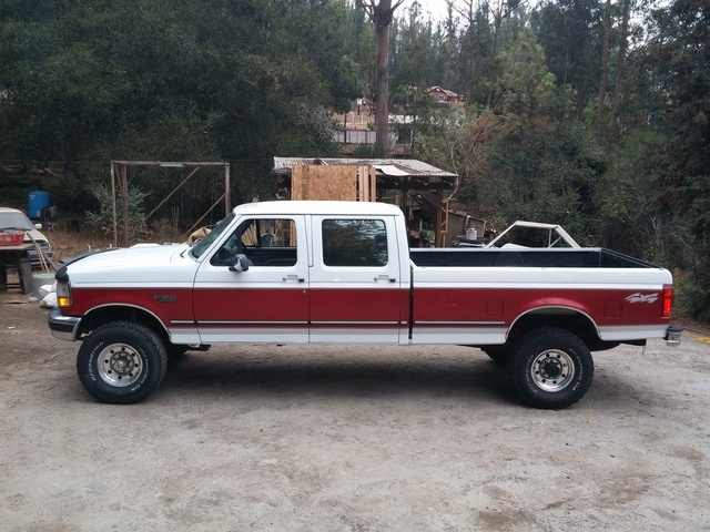 A white and red heavy duty Ford F-350 pickup truck 1996 model year