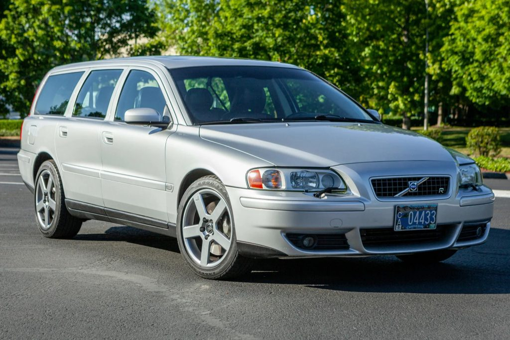 2004 Volvo V70 wagon driving on a treelined road