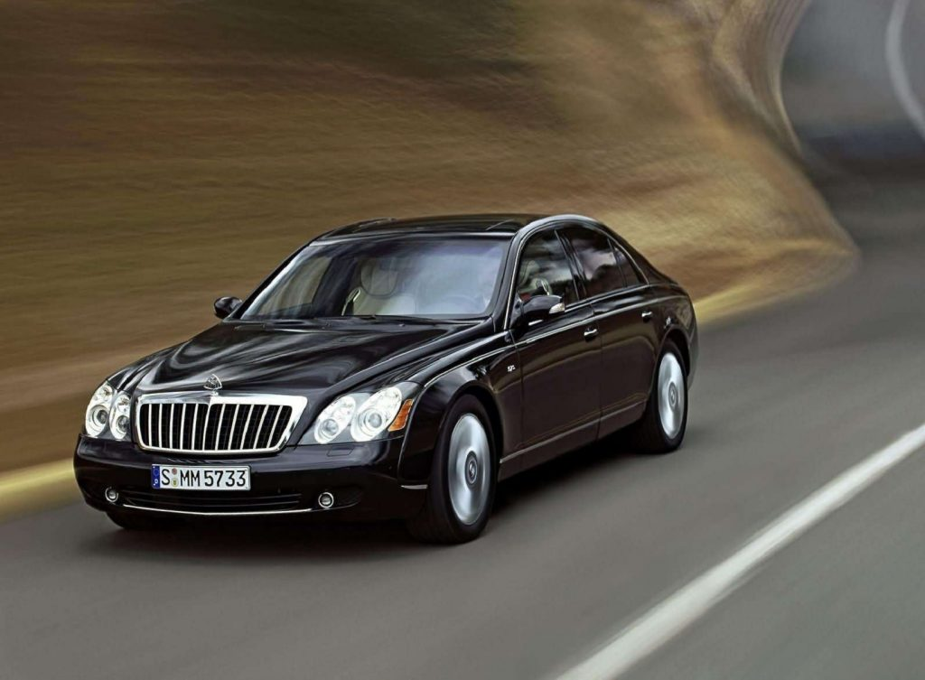A black 2005 Maybach 57s speeds down the road