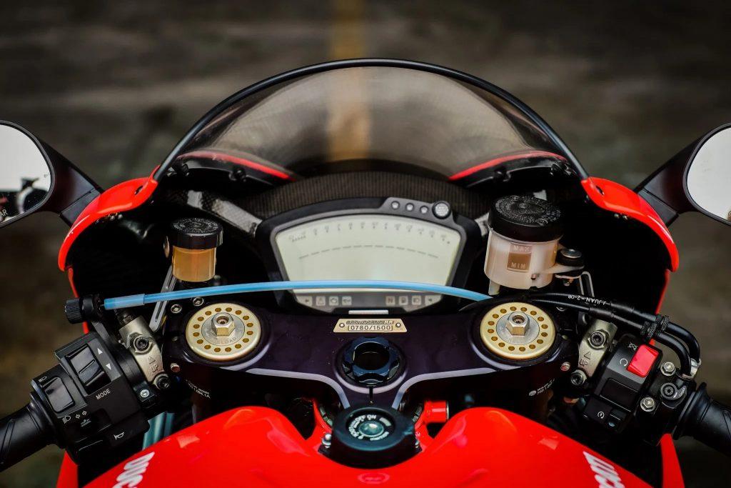 The 2008 Ducati Desmosedici RR's handlebars and digital display