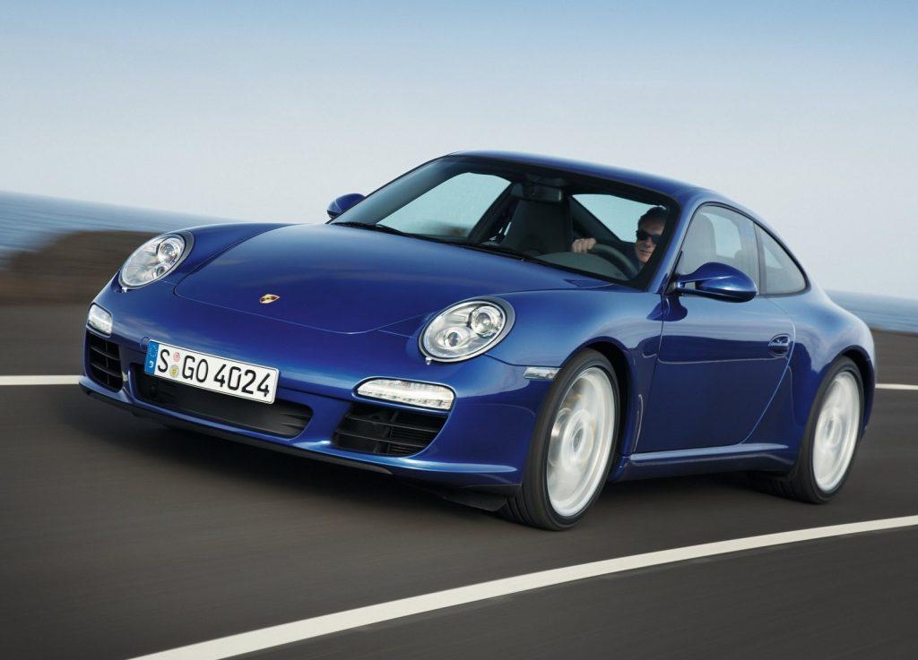 A blue 2009 Porsche 911 Carrera going around a corner