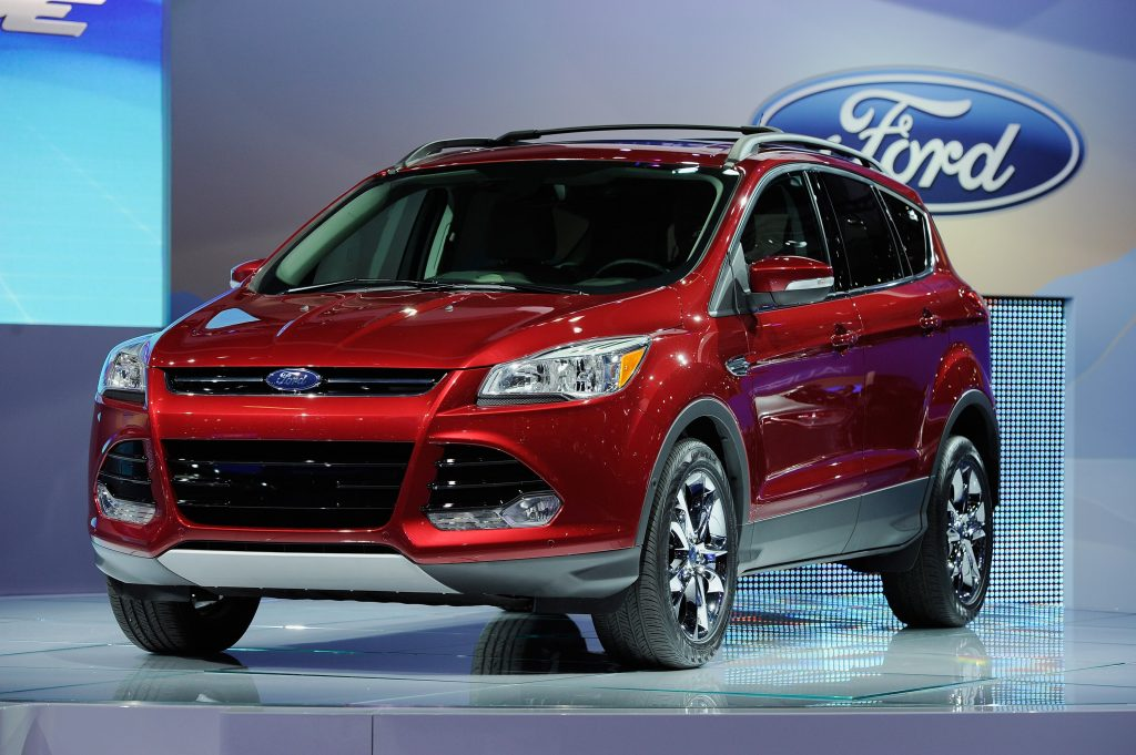 A 2011 Ford Escape SUV on display at an auto show