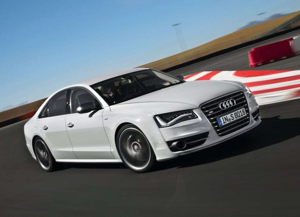 A white 2013 Audi S8 on a racetrack