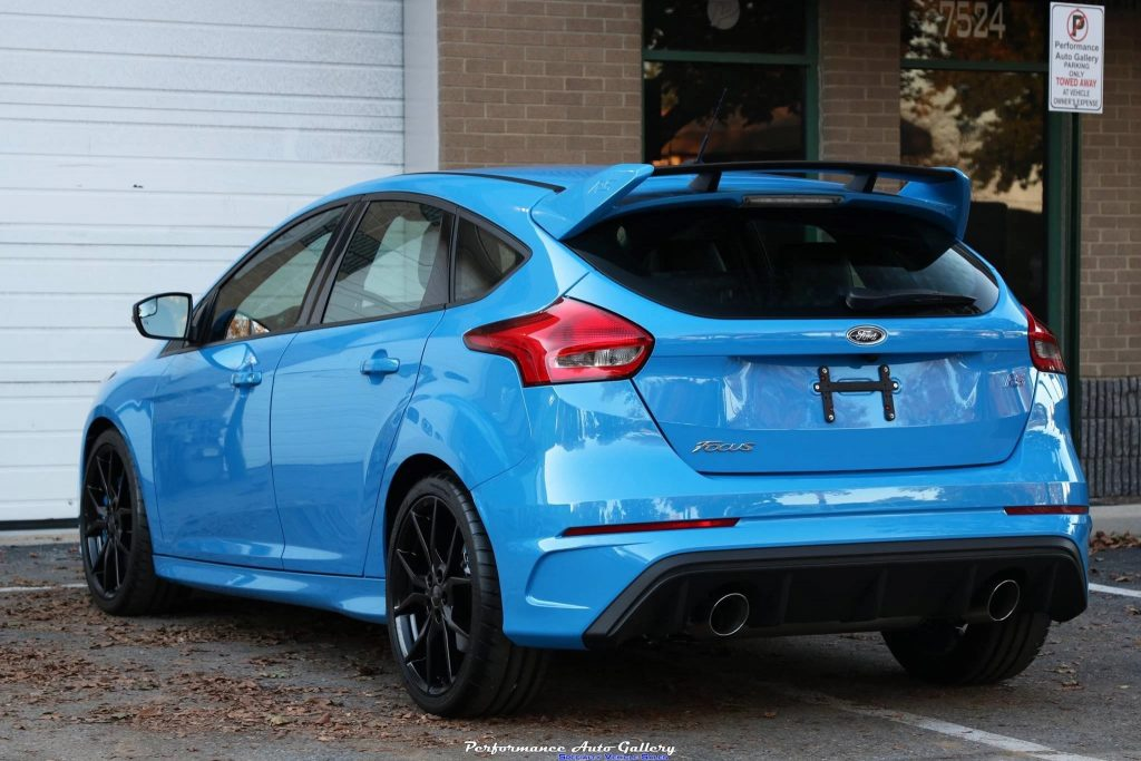 The rear of a blue 2016 Ford Focus RS