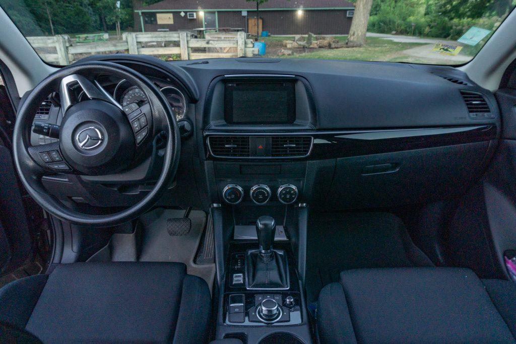 The black front interior of a 2016 Mazda CX-5 Sport