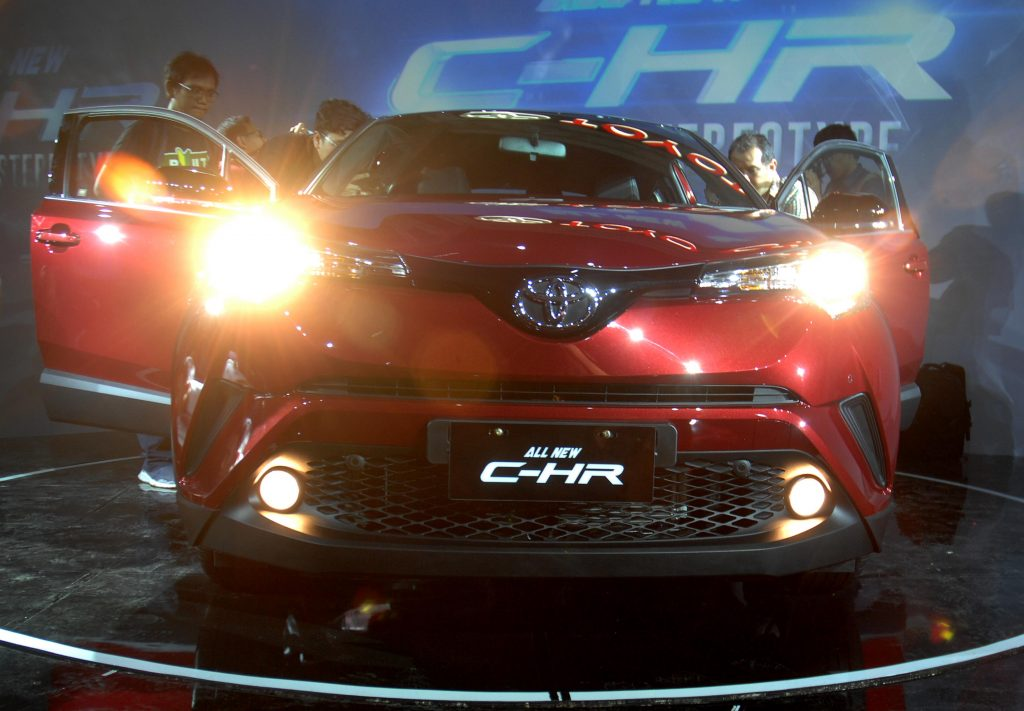 A Toyota C-HR on display at an auto show