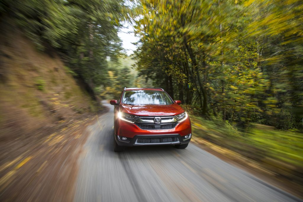 A red 2018 Honda CR-V driving down the countryside.