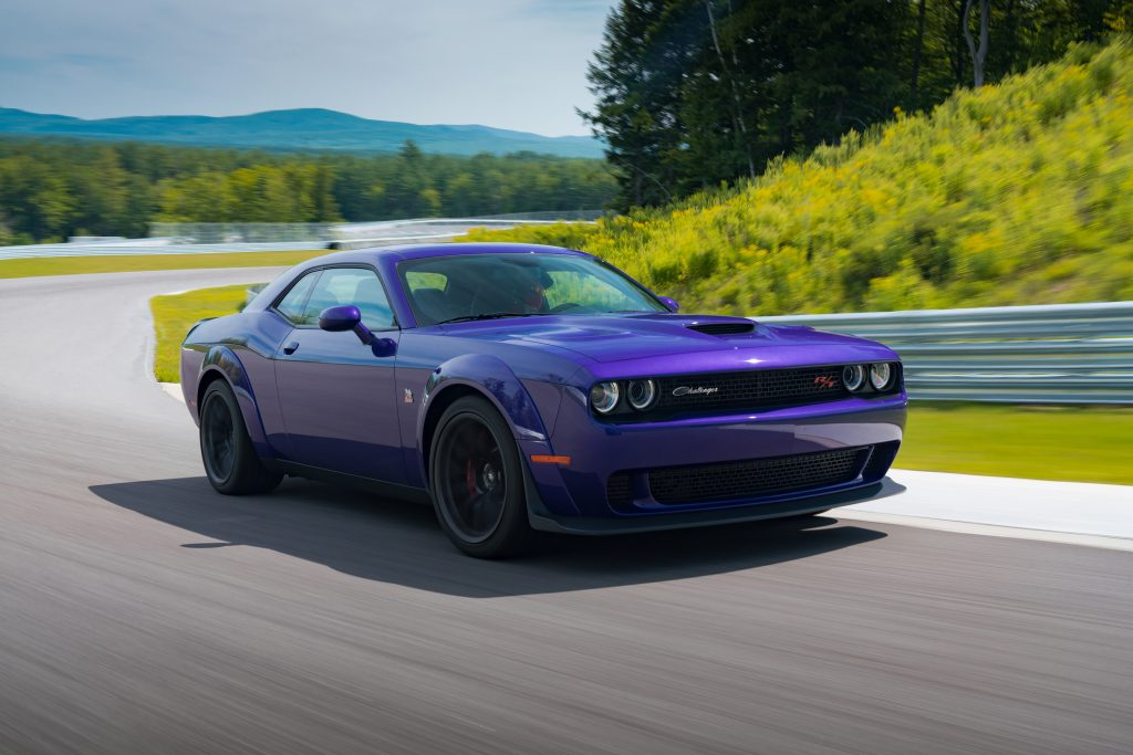 A purple 2019 Dodge Challenger R/T Scat Pack Widebody goes around a racetrack corner
