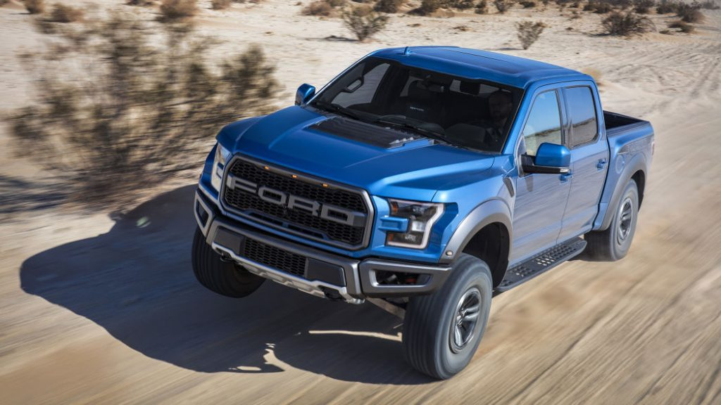 2019 Ford Raptor racing over sand