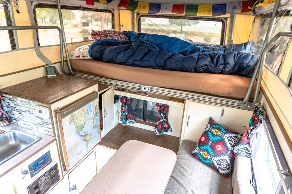 The living space inside Trazan's pop-up truck camper