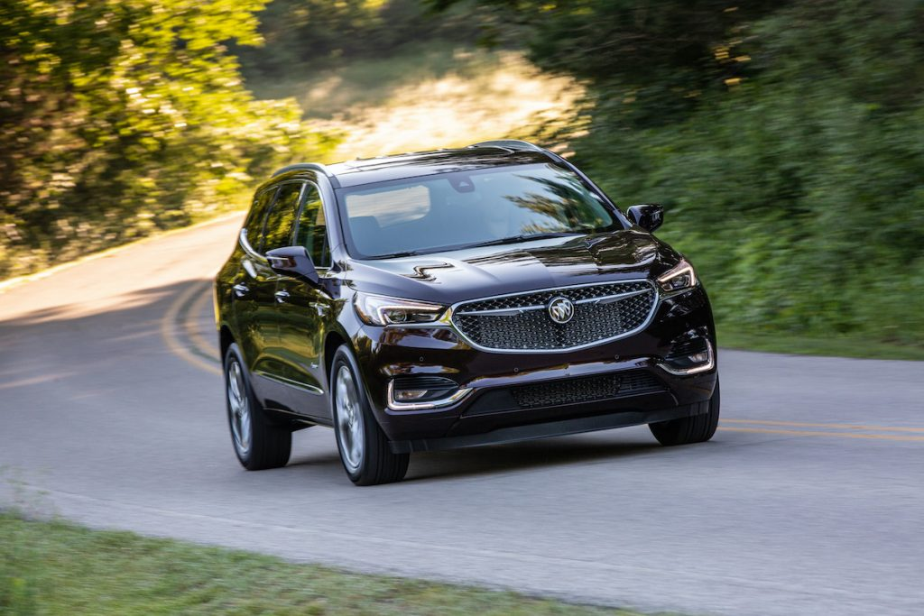 2020 Buick Enclave Avenir driving through a forest