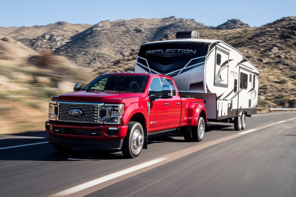 Red 2020 Ford F-250 pulling RV