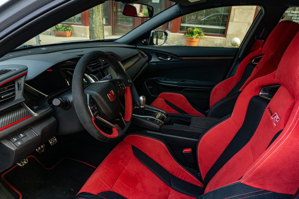 The 2020 Honda Civic Type R's front interior, showing its red sport seats