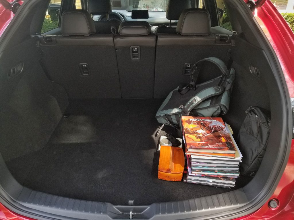 The 2020 Mazda CX-5 Signature AWD's rear cargo area, with a backpack and D&D books